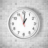 Simple clock or watch on white tile wall displaying one o&#39;clock