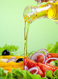 sunflower seed oil stream and healthy fresh vegetable salad