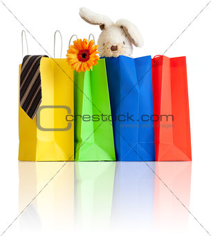 shopping bags with purchases for family on white background with