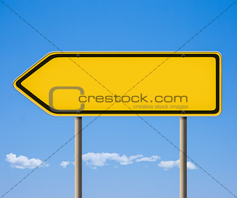 Blank yellow road sign, direction pointer against blue sky