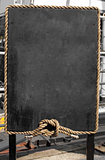 Grunge blackboard with rope frame outdoor as a background for yo