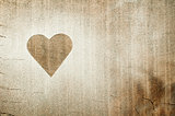 Heart pattern on an old wooden board