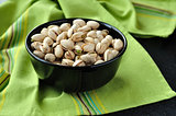 Pistachio Nuts in a Black Bowl