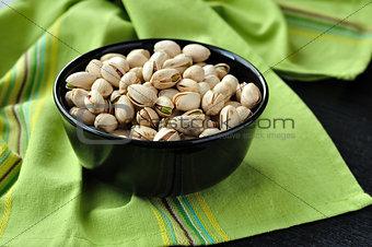 Pistachio Nuts in a Black Bowl