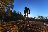 Biker Riding in Forest