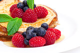 Delicious Freshly Prepared Pancakes with Honey and Berries