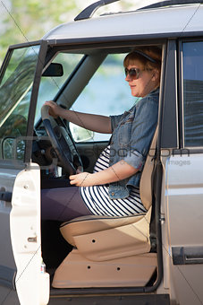 Pregnant woman at the wheel of car