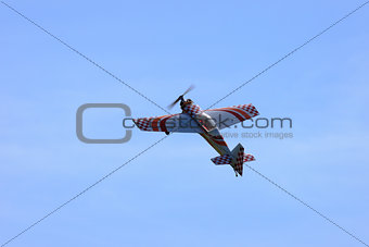 RC model airplane flying in the blue sky