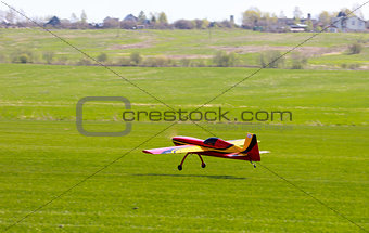 RC model airplane lands on the grass