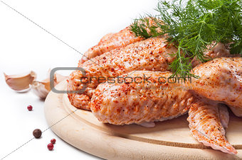 Spicy chicken wings on a wooden  board