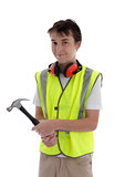 Young teen apprentice builder holding hammer