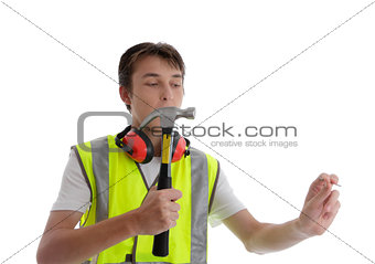 Teen apprentice with hammer and nail