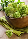 romanesco cabbage cut in a wooden bowl