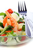 Seafood salad with green leaf,cherry tomato and cheese closeup.