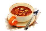 Cup of soup with seafood and tomato. 