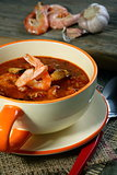 Tomato soup with seafood.
