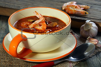 Tomato soup with mussels and shrimp.