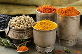 various spices (turmeric, paprika, saffron, coriander) in metal bowls