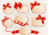 Set of beautiful retro labels with red gift bows with ribbons. Vector illustration.