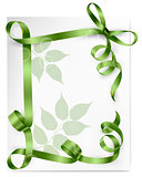 Holiday background with green gift bow with green ribbons.