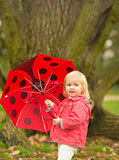 Portrait of happy baby with red umbrella outdoors