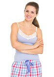 Portrait of smiling young woman in pajamas