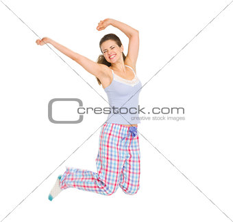 Happy girl in pajamas jumping