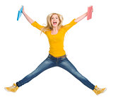 Happy student girl with books jumping