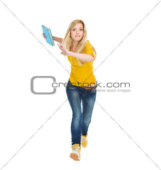 Teenage student girl with books running