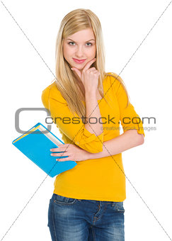 Portrait of happy student girl with book
