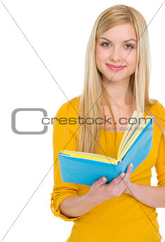 Portrait of smiling teenage student girl with book