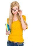 Portrait of student girl in glasses with book
