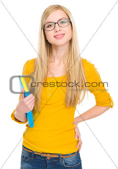 Portrait of happy student girl in glasses with book