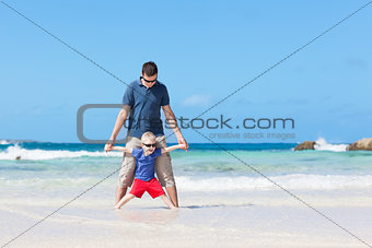 family at the tropical beach