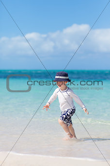 little boy at the tropical beach