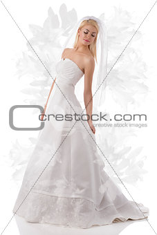 blonde bride with veil looks down at left