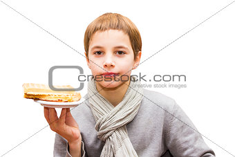 Portrait of a cute boy offering a waffle - isolated on white