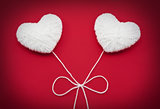 Two white hearts made from wool