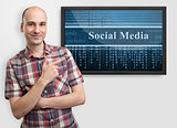 man pointing finger on screen with social media content