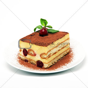 A piece of tiramisu cake on a white plate