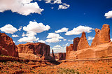 Arches National Park landscape view with blue sky and white clou