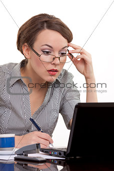 Young business woman working on notebook