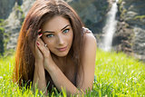Gorgeous woman laying in grass