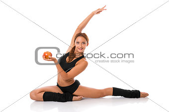 Healthy fitness woman with red apple