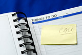 """To Do List"" on the day planner isolated on blue"