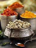 various spices (curcuma, paprika, saffron, coriander) in metal bowls