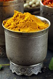 curcuma spice in metal bowl macro shot soft focus