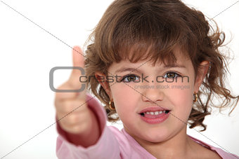 Little girl giving the thumbs-up
