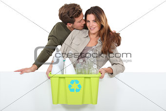 Man and woman with garbage for recycling