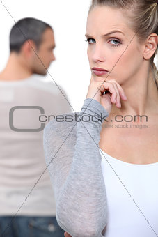 Blond woman grimacing